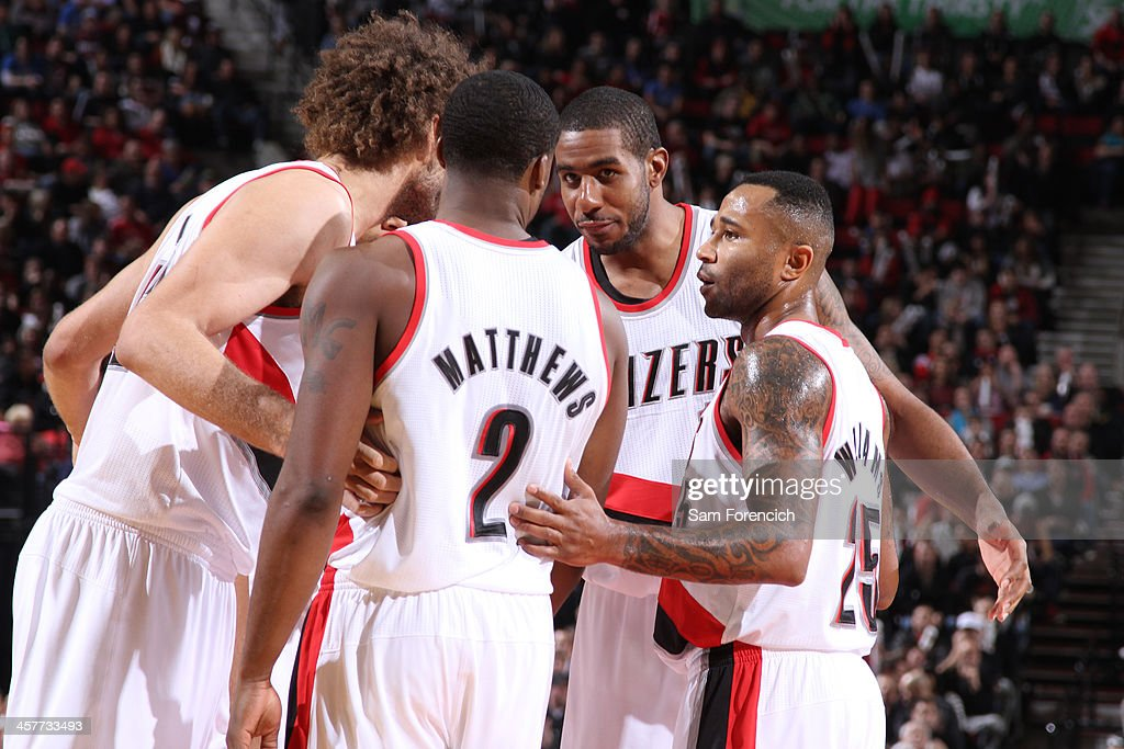 <a gi-track='captionPersonalityLinkClicked' href=/galleries/search?phrase=LaMarcus+Aldridge&family=editorial&specificpeople=453277 ng-click='$event.stopPropagation()'>LaMarcus Aldridge</a> #12 and the Portland Trail Blazers huddle up during the game against the Oklahoma City Thunder on December 4, 2013 at the Moda Center Arena in Portland, Oregon.