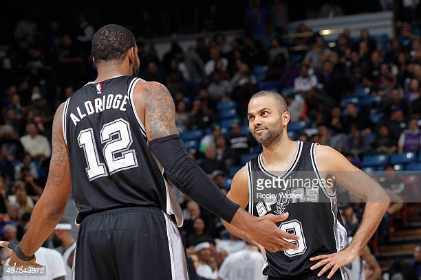 LaMarcus Aldridge and Tony Parker of the San Antonio Spurs face the Sacramento Kings on November 9 2015 at Sleep Train Arena in Sacramento California...