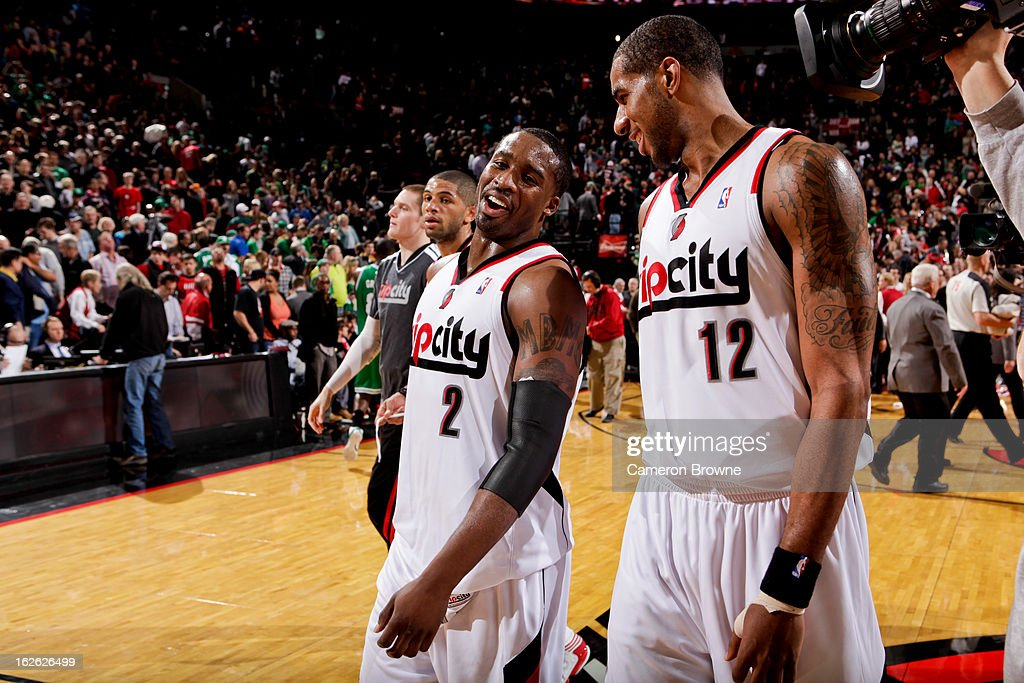 LaMarcus Aldridge #12 and Wesley Matthews #2 of the Portland Trail Blazers celebrate following their team's victory against the Boston Celtics on February 24, 2013 at the Rose Garden Arena in Portland, Oregon.