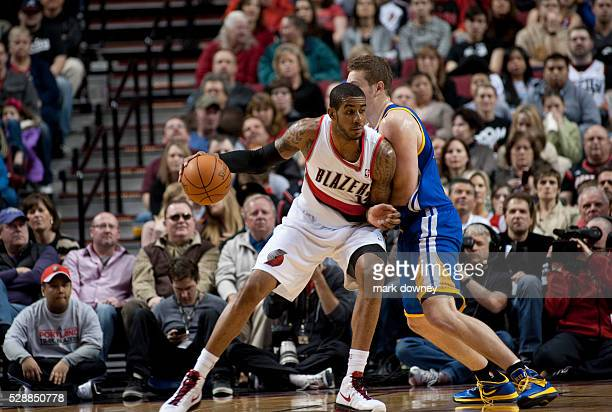 LaMarcus Aldridge maneuvers around David Lee a Golden State Warrior The Trail Blazers won 90 to 87