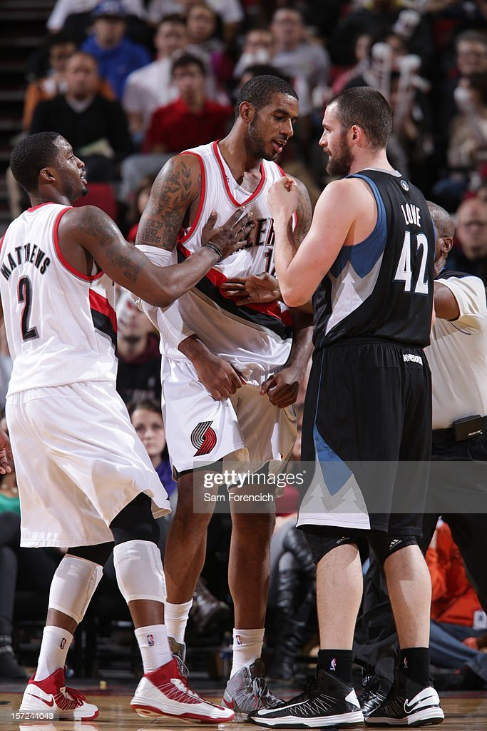 <a gi-track='captionPersonalityLinkClicked' href=/galleries/search?phrase=LaMarcus+Aldridge&family=editorial&specificpeople=453277 ng-click='$event.stopPropagation()'>LaMarcus Aldridge</a> #12 of the Portland Trail Blazers and <a gi-track='captionPersonalityLinkClicked' href=/galleries/search?phrase=Kevin+Love&family=editorial&specificpeople=4212726 ng-click='$event.stopPropagation()'>Kevin Love</a> #42 of the Minnesota Timberwolves discussing a call during a time out on November 23, 2012 at the Rose Garden Arena in Portland, Oregon.