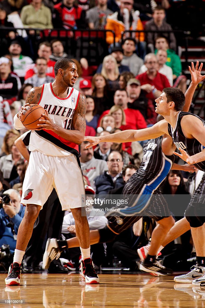 LaMarcus Aldridge #12 of the Portland Trail Blazers controls the ball against Nikola Vucevic #9 of the Orlando Magic on January 7, 2013 at the Rose Garden Arena in Portland, Oregon.