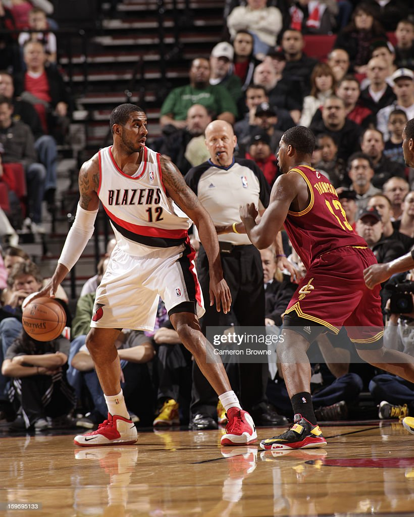 LaMarcus Aldridge #12 of the Portland Trail Blazers controls the ball against Tristan Thompson #13 of the Cleveland Cavaliers on January 16, 2013 at the Rose Garden Arena in Portland, Oregon.