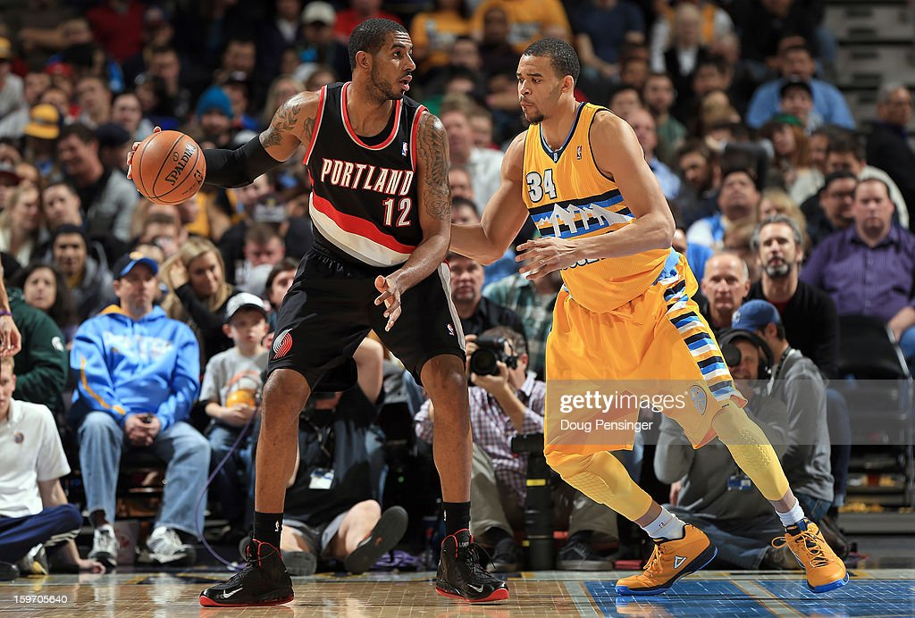 <a gi-track='captionPersonalityLinkClicked' href=/galleries/search?phrase=LaMarcus+Aldridge&family=editorial&specificpeople=453277 ng-click='$event.stopPropagation()'>LaMarcus Aldridge</a> #12 of the Portland Trail Blazers controls the ball against <a gi-track='captionPersonalityLinkClicked' href=/galleries/search?phrase=JaVale+McGee&family=editorial&specificpeople=4195625 ng-click='$event.stopPropagation()'>JaVale McGee</a> #34 of the Denver Nuggets at the Pepsi Center on January 15, 2013 in Denver, Colorado. The Nuggets defeated the Trail Blazers 115-111 in overtime.