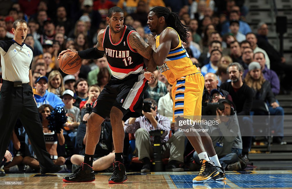 LaMarcus Aldridge #12 of the Portland Trail Blazers controls the ball against Kenneth Faried #35 of the Denver Nuggets at the Pepsi Center on January 15, 2013 in Denver, Colorado. The Nuggets defeated the Trail Blazers 115-111 in overtime.
