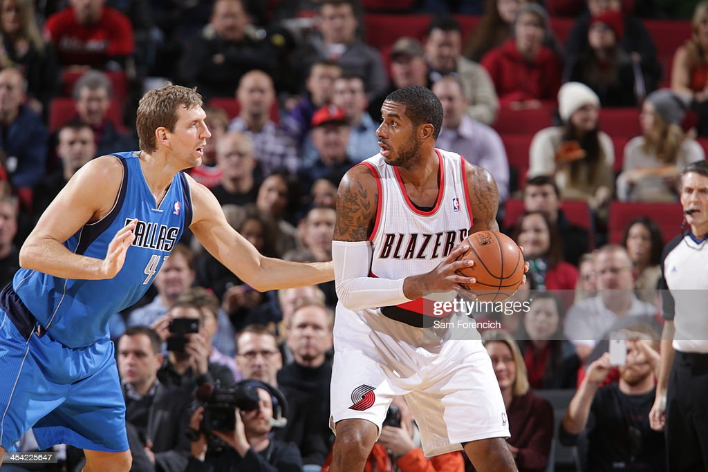 LaMarcus Aldridge of the Portland Trail Blazers controls the ball against Dirk Nowitzki of the Dallas Mavericks on December 7 2013 at the Moda Center...