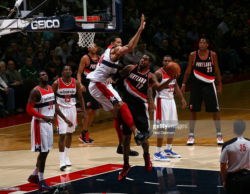<a gi-track='captionPersonalityLinkClicked' href=/galleries/search?phrase=LaMarcus+Aldridge&family=editorial&specificpeople=453277 ng-click='$event.stopPropagation()'>LaMarcus Aldridge</a> #12 of the Portland Trail Blazers drives against <a gi-track='captionPersonalityLinkClicked' href=/galleries/search?phrase=JaVale+McGee&family=editorial&specificpeople=4195625 ng-click='$event.stopPropagation()'>JaVale McGee</a> #34 of the Washington Wizards at the Verizon Center on March 10, 2012 in Washington, DC.