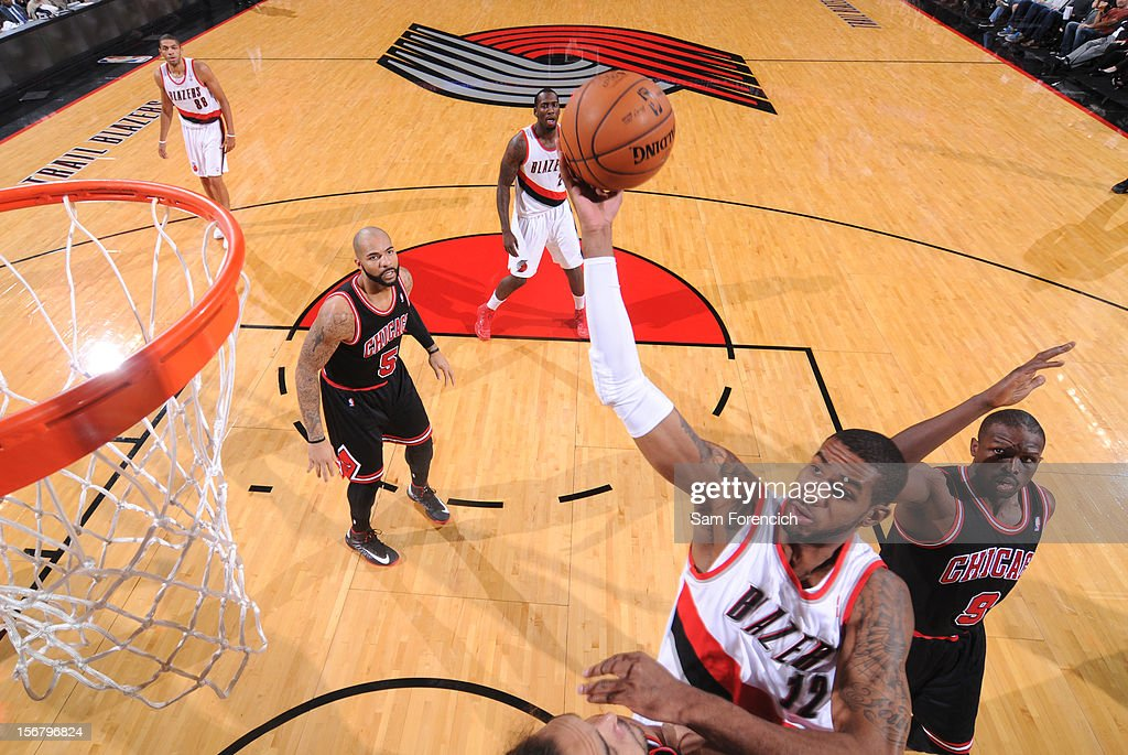<a gi-track='captionPersonalityLinkClicked' href=/galleries/search?phrase=LaMarcus+Aldridge&family=editorial&specificpeople=453277 ng-click='$event.stopPropagation()'>LaMarcus Aldridge</a> #12 of the Portland Trail Blazers drives to the basket against <a gi-track='captionPersonalityLinkClicked' href=/galleries/search?phrase=Luol+Deng&family=editorial&specificpeople=202830 ng-click='$event.stopPropagation()'>Luol Deng</a> #9 of the Chicago Bulls on November 18, 2012 at the Rose Garden Arena in Portland, Oregon.