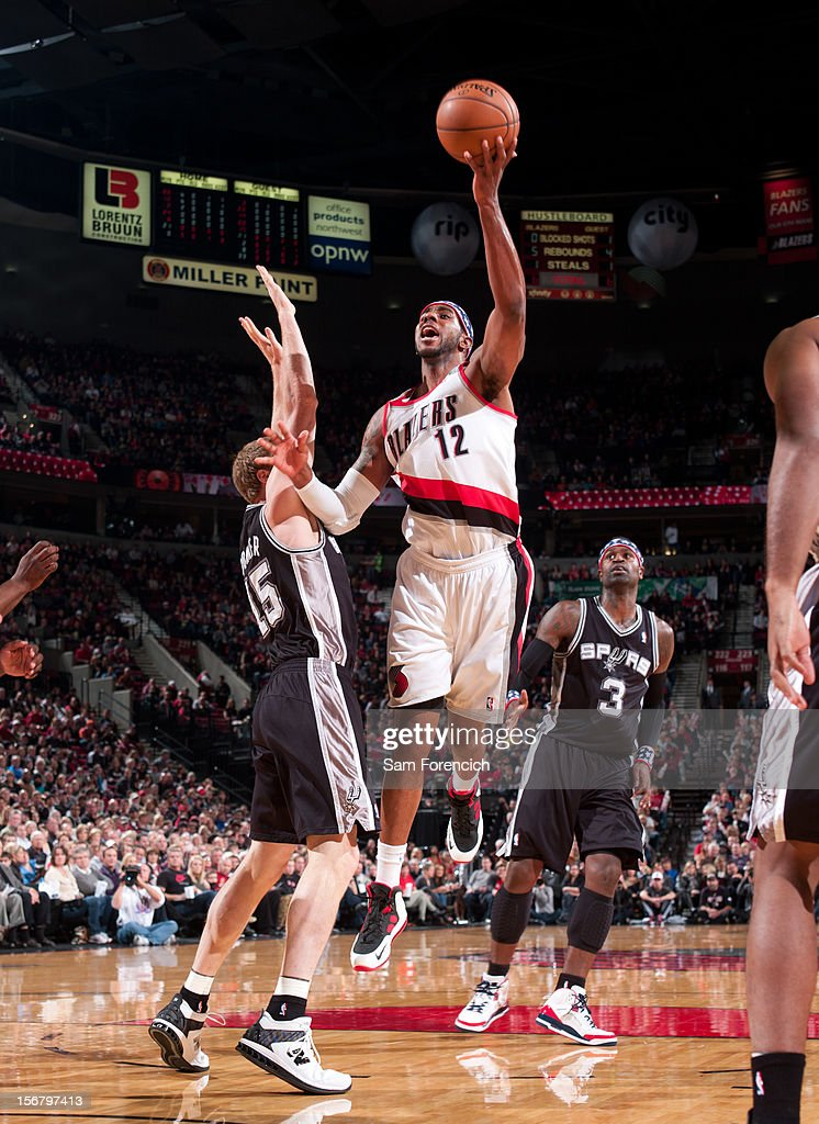 LaMarcus Aldridge #12 of the Portland Trail Blazers drives to the basket against the San Antonio Spurs on November 10, 2012 at the Rose Garden Arena in Portland, Oregon.