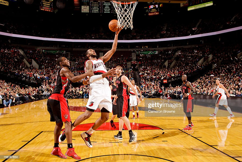 <a gi-track='captionPersonalityLinkClicked' href=/galleries/search?phrase=LaMarcus+Aldridge&family=editorial&specificpeople=453277 ng-click='$event.stopPropagation()'>LaMarcus Aldridge</a> #12 of the Portland Trail Blazers drives to the basket against the Toronto Raptors on December 10, 2012 at the Rose Garden Arena in Portland, Oregon.