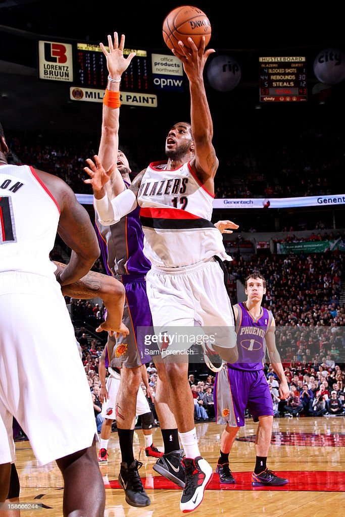 <a gi-track='captionPersonalityLinkClicked' href=/galleries/search?phrase=LaMarcus+Aldridge&family=editorial&specificpeople=453277 ng-click='$event.stopPropagation()'>LaMarcus Aldridge</a> #12 of the Portland Trail Blazers drives to the basket against <a gi-track='captionPersonalityLinkClicked' href=/galleries/search?phrase=Marcin+Gortat&family=editorial&specificpeople=589986 ng-click='$event.stopPropagation()'>Marcin Gortat</a> #4 of the Phoenix Suns on December 22, 2012 at the Rose Garden Arena in Portland, Oregon.