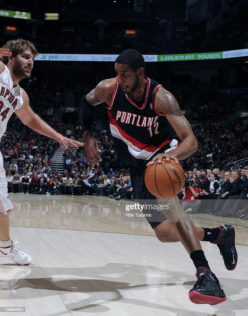 <a gi-track='captionPersonalityLinkClicked' href=/galleries/search?phrase=LaMarcus+Aldridge&family=editorial&specificpeople=453277 ng-click='$event.stopPropagation()'>LaMarcus Aldridge</a> #12 of the Portland Trail Blazers drives to the basket against the Toronto Raptors during the game on January 2, 2013 at the Air Canada Centre in Toronto, Ontario, Canada.