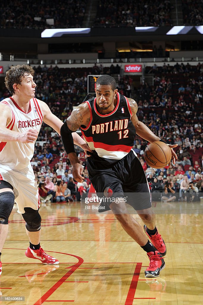 <a gi-track='captionPersonalityLinkClicked' href=/galleries/search?phrase=LaMarcus+Aldridge&family=editorial&specificpeople=453277 ng-click='$event.stopPropagation()'>LaMarcus Aldridge</a> #12 of the Portland Trail Blazers drives to the basket against the Houston Rockets on February 8, 2013 at the Toyota Center in Houston, Texas.