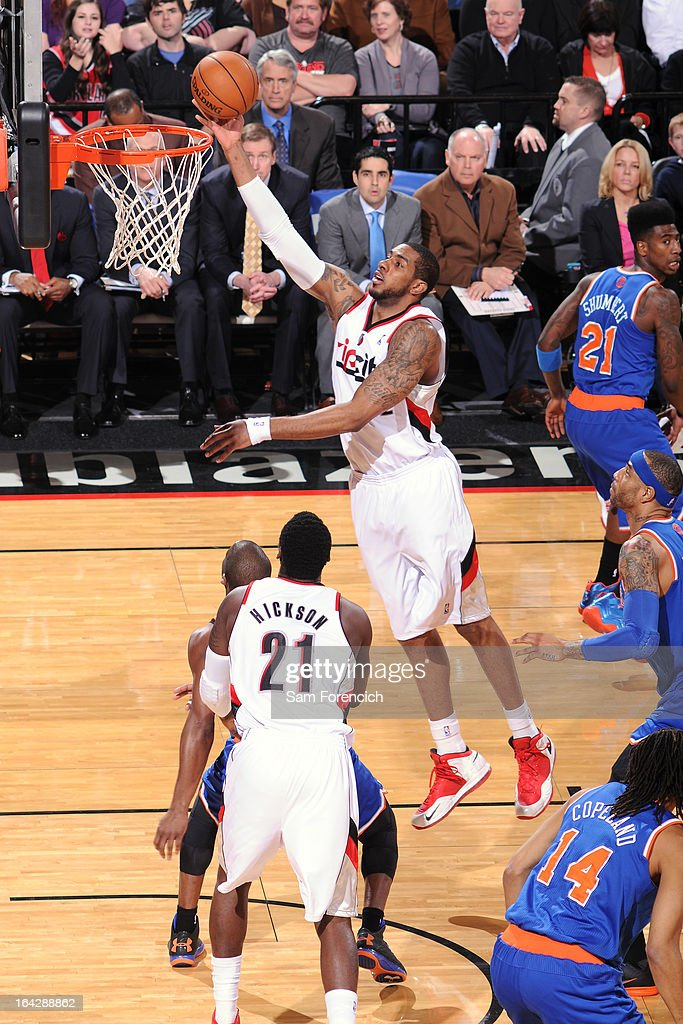 <a gi-track='captionPersonalityLinkClicked' href=/galleries/search?phrase=LaMarcus+Aldridge&family=editorial&specificpeople=453277 ng-click='$event.stopPropagation()'>LaMarcus Aldridge</a> #12 of the Portland Trail Blazers drives to the basket against the New York Knicks on March 14, 2013 at the Rose Garden Arena in Portland, Oregon.