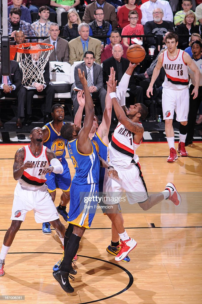 LaMarcus Aldridge #12 of the Portland Trail Blazers drives to the basket against the Golden State Warriors on April 17, 2013 at the Rose Garden Arena in Portland, Oregon.