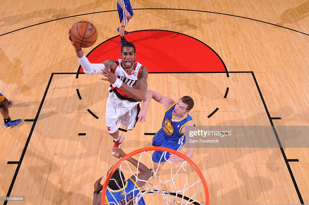 <a gi-track='captionPersonalityLinkClicked' href=/galleries/search?phrase=LaMarcus+Aldridge&family=editorial&specificpeople=453277 ng-click='$event.stopPropagation()'>LaMarcus Aldridge</a> #12 of the Portland Trail Blazers drives to the basket against the Golden State Warriors on April 17, 2013 at the Rose Garden Arena in Portland, Oregon.
