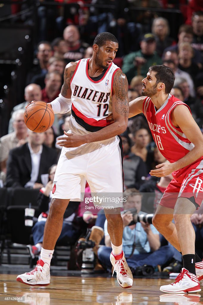 <a gi-track='captionPersonalityLinkClicked' href=/galleries/search?phrase=LaMarcus+Aldridge&family=editorial&specificpeople=453277 ng-click='$event.stopPropagation()'>LaMarcus Aldridge</a> #12 of the Portland Trail Blazers drives to the basket against the Houston Rockets on November 5, 2013 at the Moda Center Arena in Portland, Oregon.
