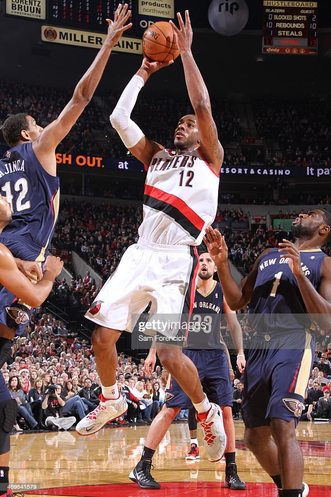 <a gi-track='captionPersonalityLinkClicked' href=/galleries/search?phrase=LaMarcus+Aldridge&family=editorial&specificpeople=453277 ng-click='$event.stopPropagation()'>LaMarcus Aldridge</a> #12 of the Portland Trail Blazers drives to the basket against the New Orleans Pelicans on December 21, 2013 at the Moda Center Arena in Portland, Oregon.