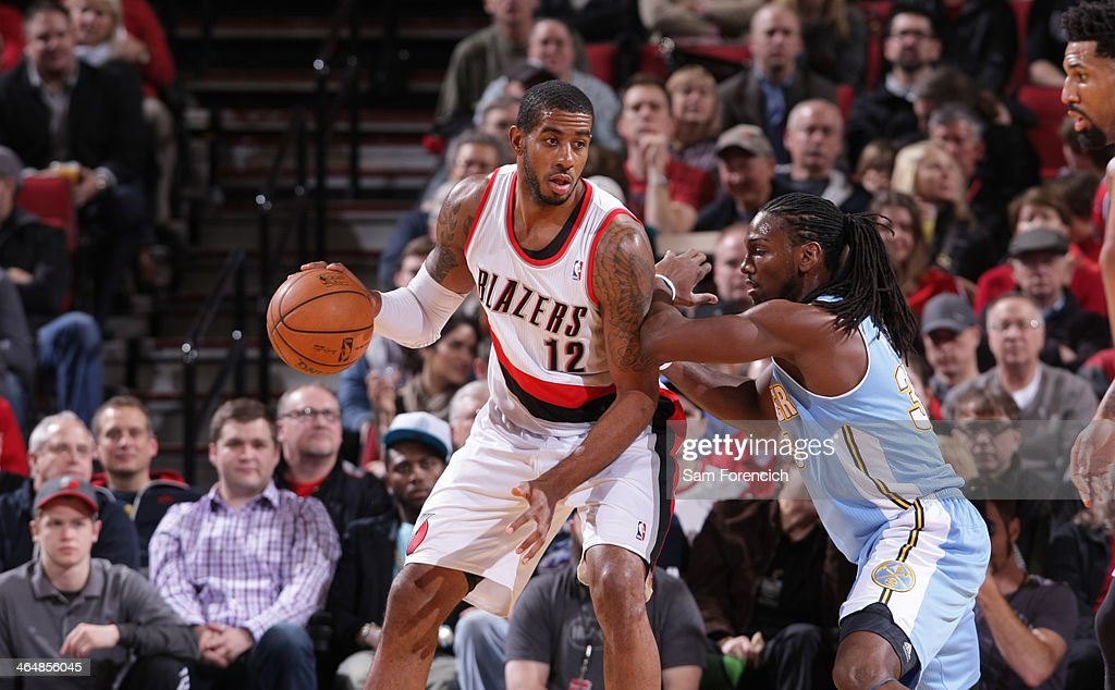 <a gi-track='captionPersonalityLinkClicked' href=/galleries/search?phrase=LaMarcus+Aldridge&family=editorial&specificpeople=453277 ng-click='$event.stopPropagation()'>LaMarcus Aldridge</a> #12 of the Portland Trail Blazers drives to the basket against the Denver Nuggets on January 23, 2014 at the Moda Center Arena in Portland, Oregon.