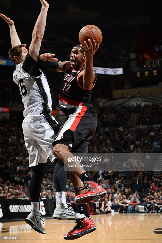 <a gi-track='captionPersonalityLinkClicked' href=/galleries/search?phrase=LaMarcus+Aldridge&family=editorial&specificpeople=453277 ng-click='$event.stopPropagation()'>LaMarcus Aldridge</a> #12 of the Portland Trail Blazers drives to the basket against Aron Baynes #16 of the San Antonio Spurs in Game One of the Western Conference Semi-Finals during the 2014 NBA Playoffs at AT&T Center on May 6, 2014 in San Antonio, Texas.