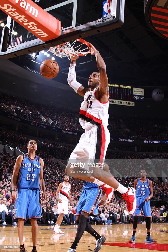 LaMarcus Aldridge #12 of the Portland Trail Blazers dunks against the Oklahoma City Thunder on January 13, 2013 at the Rose Garden Arena in Portland, Oregon.
