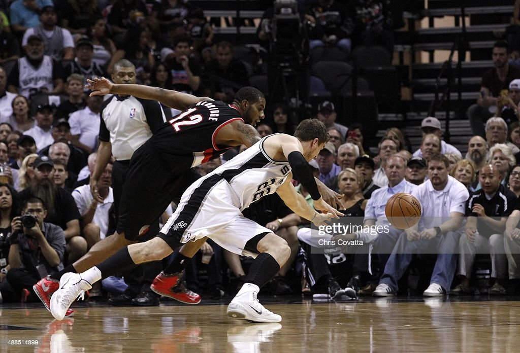<a gi-track='captionPersonalityLinkClicked' href=/galleries/search?phrase=LaMarcus+Aldridge&family=editorial&specificpeople=453277 ng-click='$event.stopPropagation()'>LaMarcus Aldridge</a> #12 of the Portland Trail Blazers fights for a loose ball with <a gi-track='captionPersonalityLinkClicked' href=/galleries/search?phrase=Tiago+Splitter&family=editorial&specificpeople=208218 ng-click='$event.stopPropagation()'>Tiago Splitter</a> #22 of the San Antonio Spurs in Game One of the Western Conference Semifinals during the 2014 NBA Playoffs at the AT&T Center on May 6, 2014 in San Antonio, Texas.