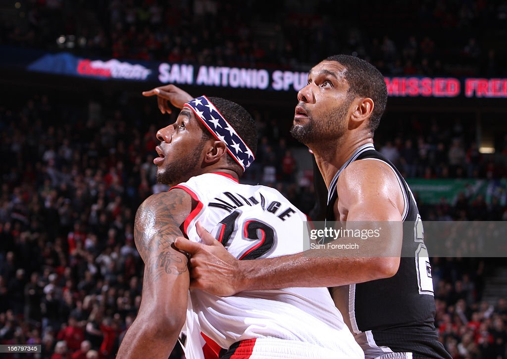 LaMarcus Aldridge #12 of the Portland Trail Blazers fights for position against Tim Duncan #21 of the San Antonio Spurs on November 10, 2012 at the Rose Garden Arena in Portland, Oregon.