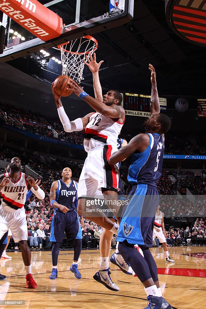 LaMarcus Aldridge #12 of the Portland Trail Blazers goes to the basket against Bernard James #5 of the Dallas Mavericks during the game between the Dallas Mavericks and the Portland Trail Blazers on January 29, 2013 at the Rose Garden Arena in Portland, Oregon.