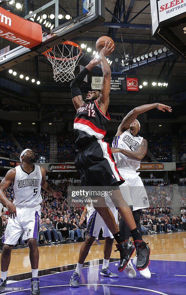 <a gi-track='captionPersonalityLinkClicked' href=/galleries/search?phrase=LaMarcus+Aldridge&family=editorial&specificpeople=453277 ng-click='$event.stopPropagation()'>LaMarcus Aldridge</a> #12 of the Portland Trail Blazers goes up for the shot against John Salmons #5 and James Johnson #52 of the Sacramento Kings on December 23, 2012 at Sleep Train Arena in Sacramento, California.
