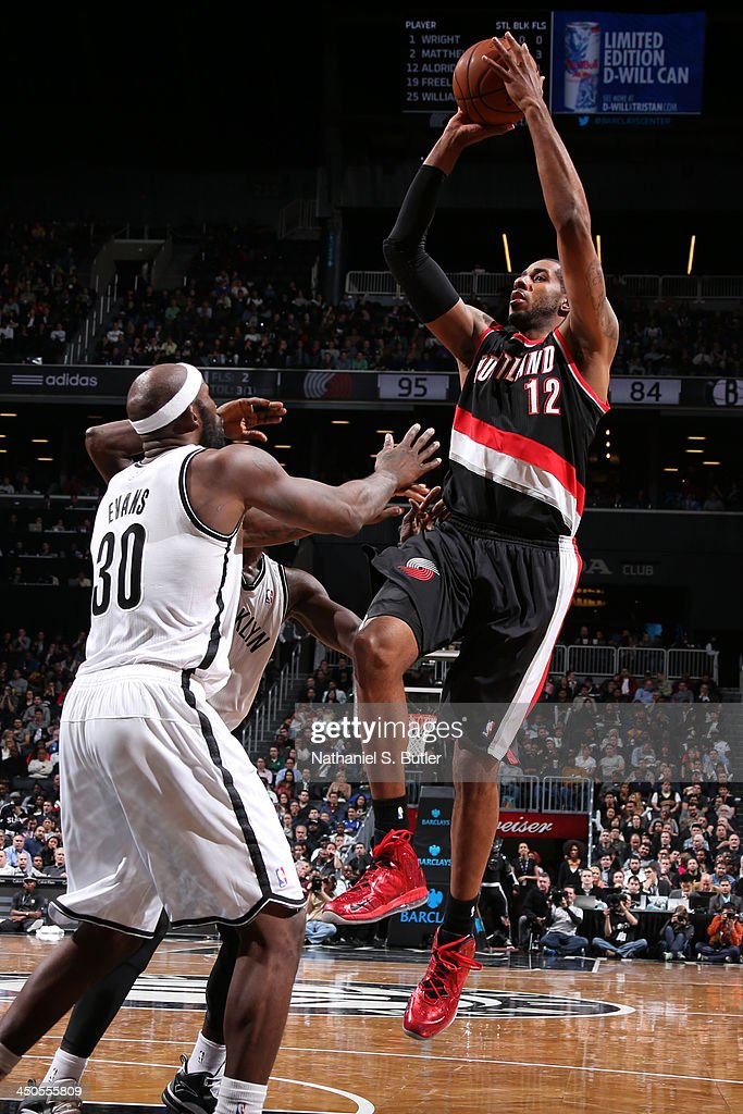 <a gi-track='captionPersonalityLinkClicked' href=/galleries/search?phrase=LaMarcus+Aldridge&family=editorial&specificpeople=453277 ng-click='$event.stopPropagation()'>LaMarcus Aldridge</a> #12 of the Portland Trail Blazers goes up to shoot during a game against the Brooklyn Nets at Barclays Center on November 18, 2013 in the Brooklyn borough of New York City.