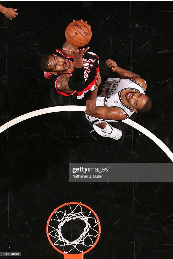 <a gi-track='captionPersonalityLinkClicked' href=/galleries/search?phrase=LaMarcus+Aldridge&family=editorial&specificpeople=453277 ng-click='$event.stopPropagation()'>LaMarcus Aldridge</a> #12 of the Portland Trail Blazers grabs a rebound against <a gi-track='captionPersonalityLinkClicked' href=/galleries/search?phrase=Alan+Anderson&family=editorial&specificpeople=3945355 ng-click='$event.stopPropagation()'>Alan Anderson</a> #6 of the Brooklyn Nets at Barclays Center on November 18, 2013 in the Brooklyn borough of New York City.