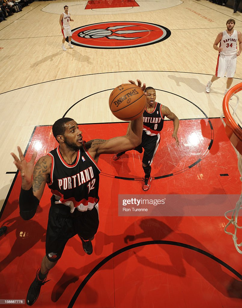 LaMarcus Aldridge #12 of the Portland Trail Blazers grabs a rebound against the Toronto Raptors during the game on January 2, 2013 at the Air Canada Centre in Toronto, Ontario, Canada.