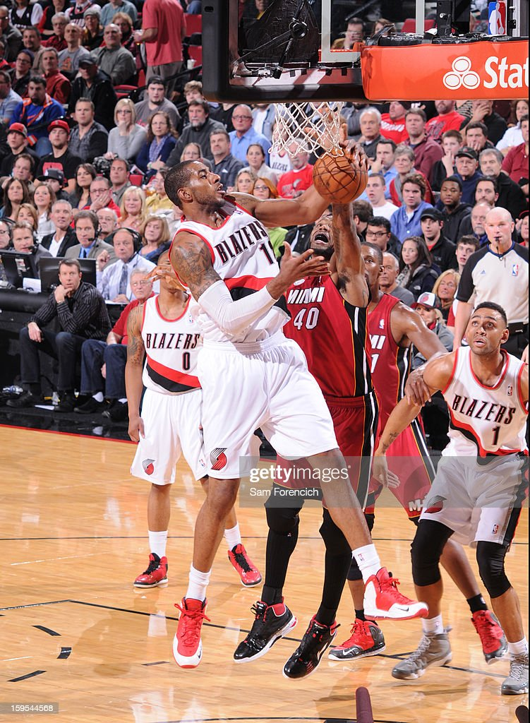 <a gi-track='captionPersonalityLinkClicked' href=/galleries/search?phrase=LaMarcus+Aldridge&family=editorial&specificpeople=453277 ng-click='$event.stopPropagation()'>LaMarcus Aldridge</a> #12 of the Portland Trail Blazers grabs a rebound against the Miami Heat on January 10, 2013 at the Rose Garden Arena in Portland, Oregon.