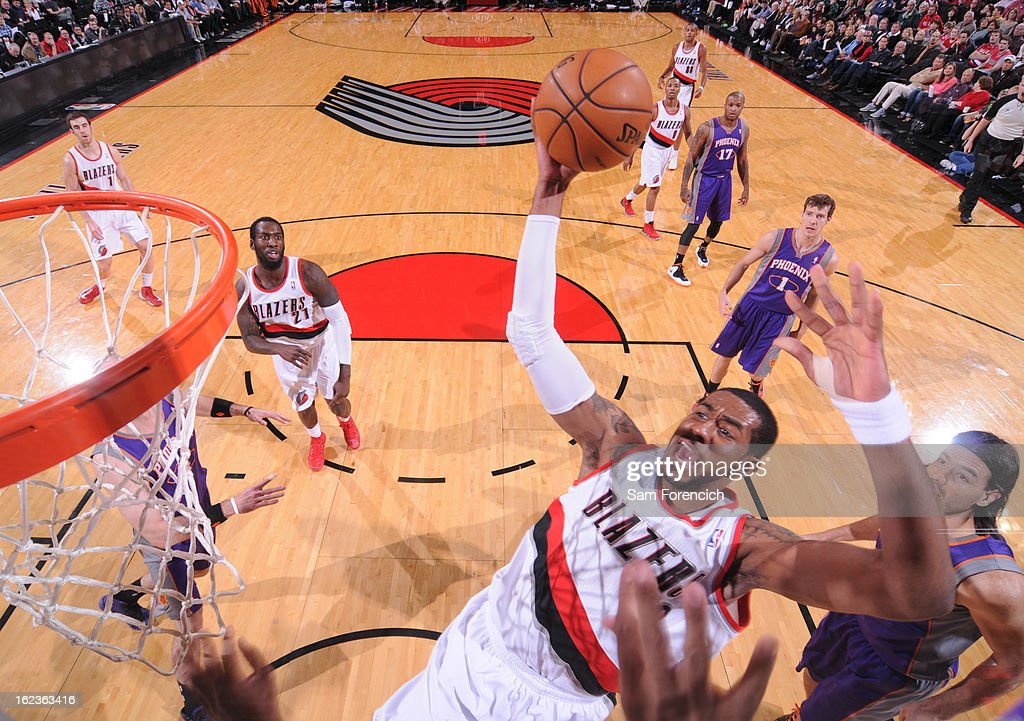 <a gi-track='captionPersonalityLinkClicked' href=/galleries/search?phrase=LaMarcus+Aldridge&family=editorial&specificpeople=453277 ng-click='$event.stopPropagation()'>LaMarcus Aldridge</a> #12 of the Portland Trail Blazers grabs a rebound against the Phoenix Suns on February 19, 2013 at the Rose Garden Arena in Portland, Oregon.