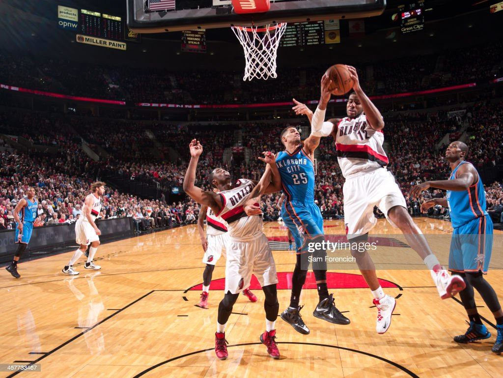 <a gi-track='captionPersonalityLinkClicked' href=/galleries/search?phrase=LaMarcus+Aldridge&family=editorial&specificpeople=453277 ng-click='$event.stopPropagation()'>LaMarcus Aldridge</a> #12 of the Portland Trail Blazers grabs a rebound against the Oklahoma City Thunder on December 4, 2013 at the Moda Center Arena in Portland, Oregon.