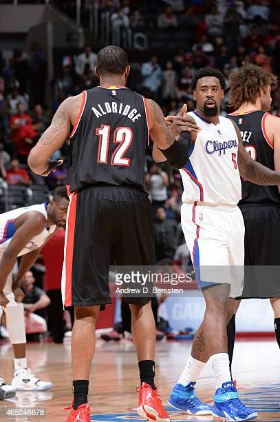 LaMarcus Aldridge of the Portland Trail Blazers greets DeAndre Jordan of the Los Angeles Clippers before the game on March 4 2015 at Staples Center...
