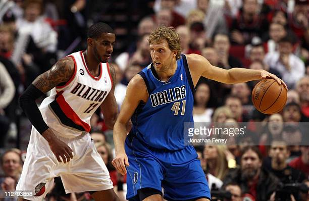 LaMarcus Aldridge of the Portland Trail Blazers guards Dirk Nowitzki of the Dallas Mavericks in Game Three of the Western Conference Quarterfinals in...