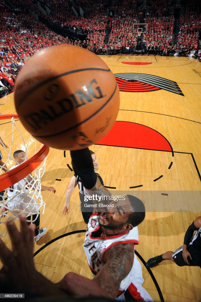<a gi-track='captionPersonalityLinkClicked' href=/galleries/search?phrase=LaMarcus+Aldridge&family=editorial&specificpeople=453277 ng-click='$event.stopPropagation()'>LaMarcus Aldridge</a> #12 of the Portland Trail Blazers lays the ball in the basket in Game Three of the Western Conference Semifinals against the San Antonio Spurs during the 2014 NBA Playoffs on May 10, 2014 at the Moda Center in Portland, Oregon.