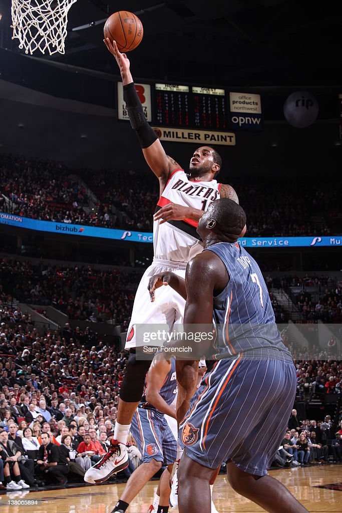 LaMarcus Aldridge #12 of the Portland Trail Blazers lays the ball up over DeSagana Diop #7 of the Charlotte Bobcats on February 1, 2012 at the Rose Garden Arena in Portland, Oregon.