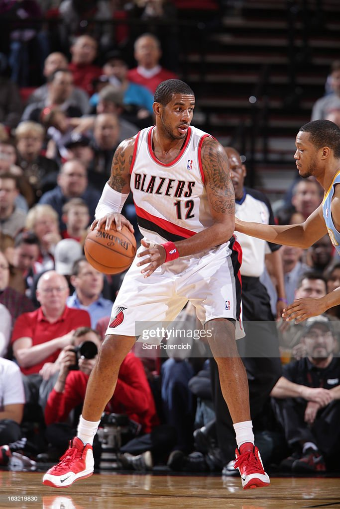 <a gi-track='captionPersonalityLinkClicked' href=/galleries/search?phrase=LaMarcus+Aldridge&family=editorial&specificpeople=453277 ng-click='$event.stopPropagation()'>LaMarcus Aldridge</a> #12 of the Portland Trail Blazers looks to drive to the basket against the Denver Nuggets on February 27, 2013 at the Rose Garden Arena in Portland, Oregon.