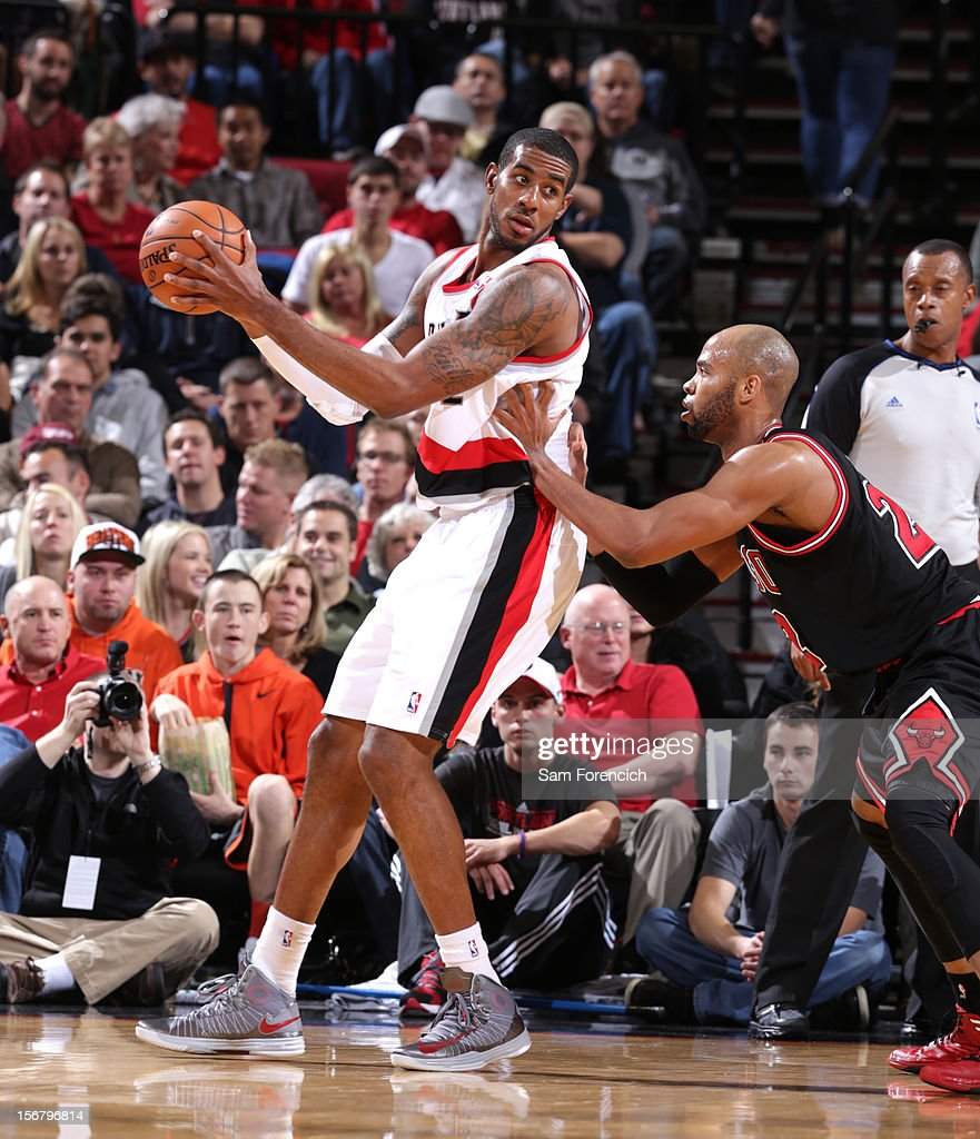 <a gi-track='captionPersonalityLinkClicked' href=/galleries/search?phrase=LaMarcus+Aldridge&family=editorial&specificpeople=453277 ng-click='$event.stopPropagation()'>LaMarcus Aldridge</a> #12 of the Portland Trail Blazers looks to make a move against <a gi-track='captionPersonalityLinkClicked' href=/galleries/search?phrase=Taj+Gibson&family=editorial&specificpeople=4029461 ng-click='$event.stopPropagation()'>Taj Gibson</a> #22 of the Chicago Bulls on November 18, 2012 at the Rose Garden Arena in Portland, Oregon.