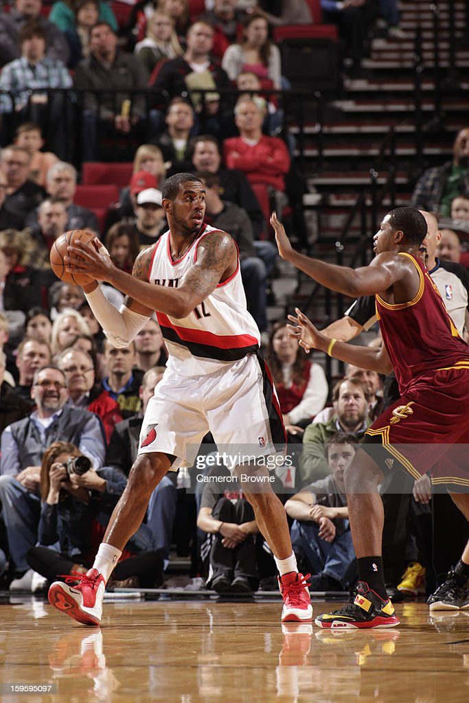 LaMarcus Aldridge #12 of the Portland Trail Blazers looks to pass the ball against Tristan Thompson #13 of the Cleveland Cavaliers on January 16, 2013 at the Rose Garden Arena in Portland, Oregon.