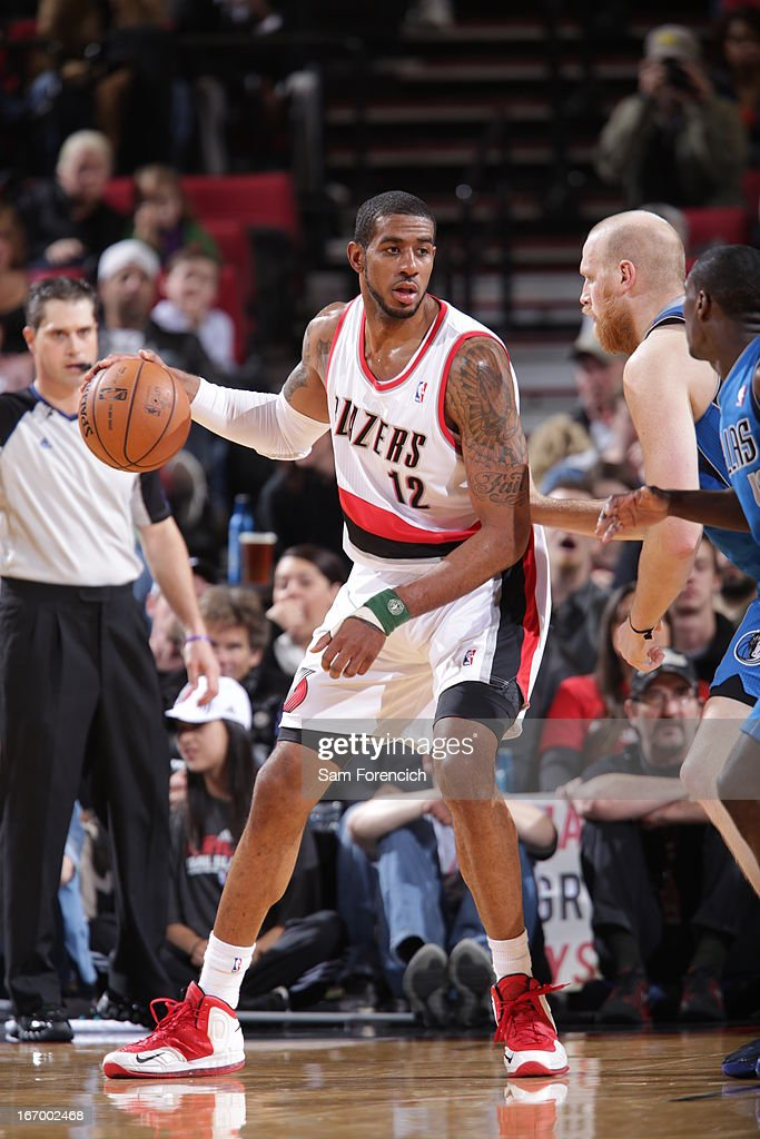 <a gi-track='captionPersonalityLinkClicked' href=/galleries/search?phrase=LaMarcus+Aldridge&family=editorial&specificpeople=453277 ng-click='$event.stopPropagation()'>LaMarcus Aldridge</a> #12 of the Portland Trail Blazers looks to pass the ball against the Dallas Mavericks on April 7, 2013 at the Rose Garden Arena in Portland, Oregon.
