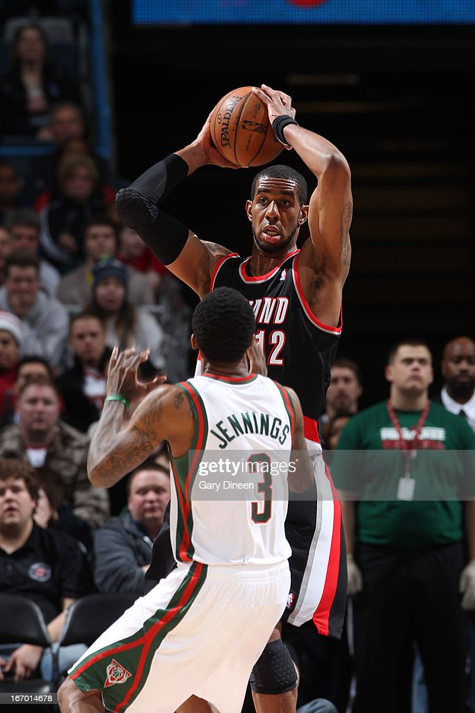 <a gi-track='captionPersonalityLinkClicked' href=/galleries/search?phrase=LaMarcus+Aldridge&family=editorial&specificpeople=453277 ng-click='$event.stopPropagation()'>LaMarcus Aldridge</a> #12 of the Portland Trail Blazers looks to pass the ball against Brandon Jennings #3 of the Milwaukee Bucks on March 19, 2013 at the BMO Harris Bradley Center in Milwaukee, Wisconsin.