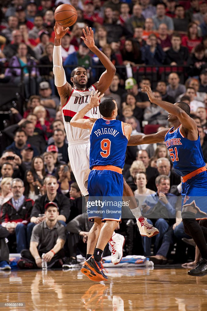 <a gi-track='captionPersonalityLinkClicked' href=/galleries/search?phrase=LaMarcus+Aldridge&family=editorial&specificpeople=453277 ng-click='$event.stopPropagation()'>LaMarcus Aldridge</a> #12 of the Portland Trail Blazers passes the ball against the New York Knicks on November 25, 2013 at the Moda Center Arena in Portland, Oregon.