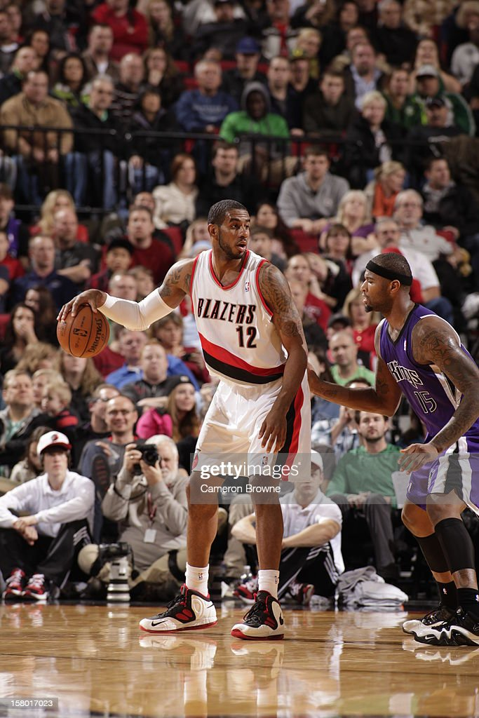 <a gi-track='captionPersonalityLinkClicked' href=/galleries/search?phrase=LaMarcus+Aldridge&family=editorial&specificpeople=453277 ng-click='$event.stopPropagation()'>LaMarcus Aldridge</a> #12 of the Portland Trail Blazers protects the ball from <a gi-track='captionPersonalityLinkClicked' href=/galleries/search?phrase=DeMarcus+Cousins&family=editorial&specificpeople=5792008 ng-click='$event.stopPropagation()'>DeMarcus Cousins</a> #15 of the Sacramento Kings during the game between the Sacramento Kings and the Portland Trail Blazers on December 8, 2012 at the Rose Garden Arena in Portland, Oregon.