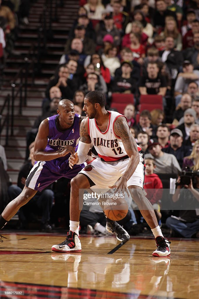 <a gi-track='captionPersonalityLinkClicked' href=/galleries/search?phrase=LaMarcus+Aldridge&family=editorial&specificpeople=453277 ng-click='$event.stopPropagation()'>LaMarcus Aldridge</a> #12 of the Portland Trail Blazers protects the ball from <a gi-track='captionPersonalityLinkClicked' href=/galleries/search?phrase=Travis+Outlaw&family=editorial&specificpeople=203322 ng-click='$event.stopPropagation()'>Travis Outlaw</a> #25 of the Sacramento Kings during the game between the Sacramento Kings and the Portland Trail Blazers on December 8, 2012 at the Rose Garden Arena in Portland, Oregon.