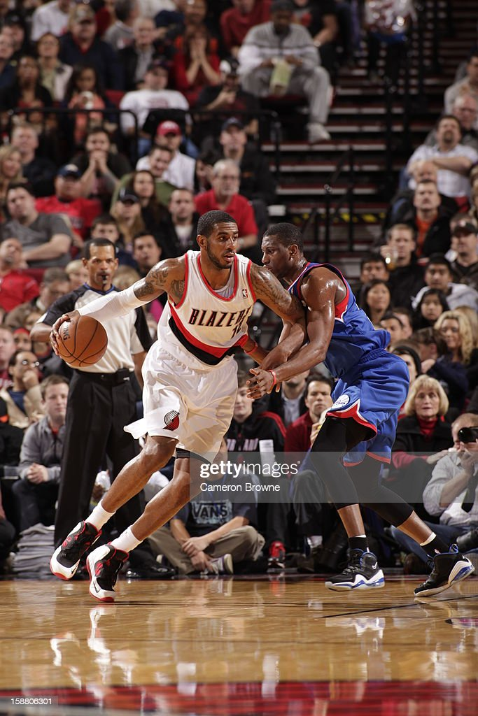 <a gi-track='captionPersonalityLinkClicked' href=/galleries/search?phrase=LaMarcus+Aldridge&family=editorial&specificpeople=453277 ng-click='$event.stopPropagation()'>LaMarcus Aldridge</a> #12 of the Portland Trail Blazers protects the ball during the game between the Philadelphia 76ers and the Portland Trail Blazers on December 29, 2012 at the Rose Garden Arena in Portland, Oregon.