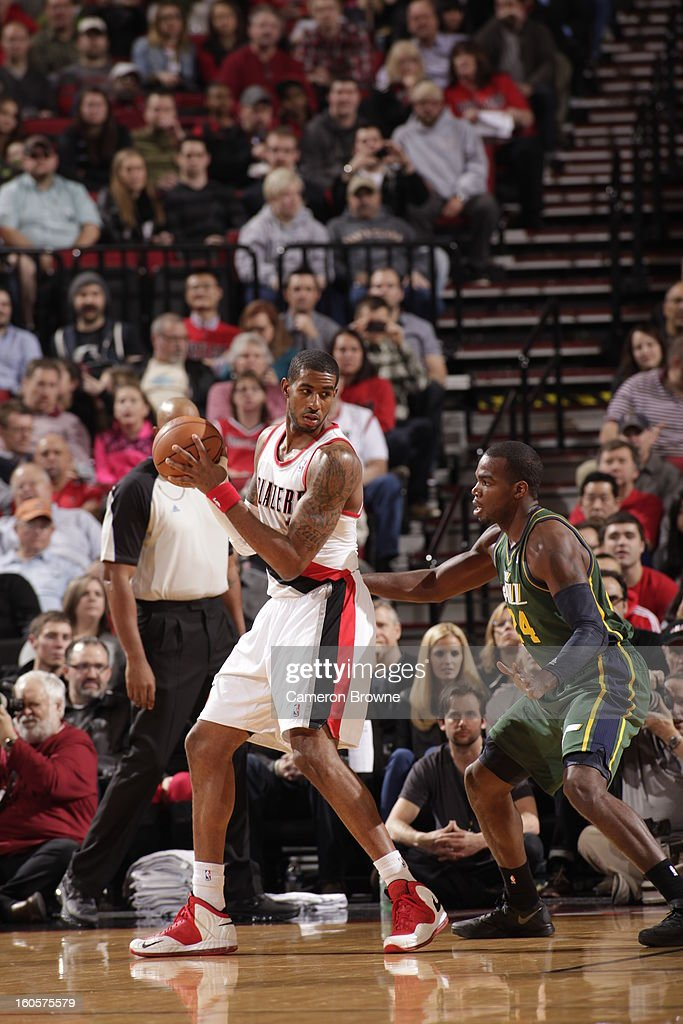 LaMarcus Aldridge #12 of the Portland Trail Blazers protects the ball from Paul Millsap #24 of the Utah Jazz during the game between the Utah Jazz and the Portland Trail Blazers on February 2, 2013 at the Rose Garden Arena in Portland, Oregon.
