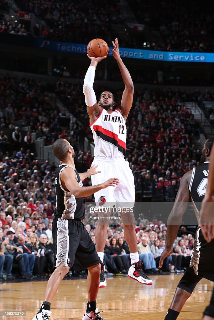 <a gi-track='captionPersonalityLinkClicked' href=/galleries/search?phrase=LaMarcus+Aldridge&family=editorial&specificpeople=453277 ng-click='$event.stopPropagation()'>LaMarcus Aldridge</a> #12 of the Portland Trail Blazers puts up a shot over Tony Parker #9 of the San Antonio Spurs on December 13, 2012 at the Rose Garden Arena in Portland, Oregon.